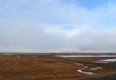 ARM-ACME V researchers are studying populations of liquid droplets and ice crystals in clouds such these seen above the arctic tundra at the ARM Facility at Oliktok Point.