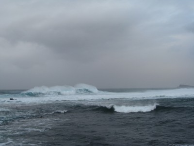Big waves, high winds and gray skies have continued much of the time so far.