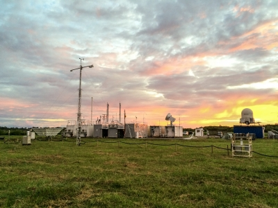 The first ARM Mobile Facility (AMF1) is lit up by a stunning sunset outside of Manaus, Brazil.
