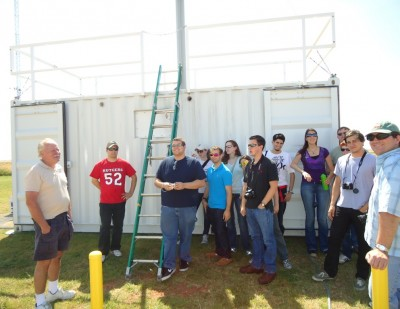 Scientist Gunnar Senum (far left) from Brookhaven National Laboratory describes the aerosol observing system to a group of visiting meteorology students from Rutgers University.