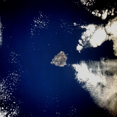 Ascension Island, a tiny speck of land between South America and Africa, is perfectly positioned to support the LASIC field campaign to study the effect of smoke on low clouds. Image courtesy of NASA.
