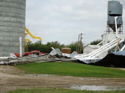 Nardin grain elevator lies crumpled on the ground.