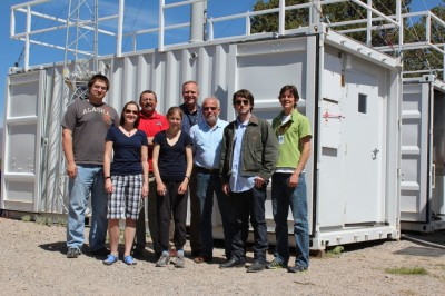 The science and operations team at Los Alamos National Laboratory poses in front of the MAOS Aerosol and Chemistry units. From left to right: Kyle Gorkowski, Alison Aitken, Paul Ortega, Anna Trugman, Kim Nitschke, Manvendra Dubey, Caleb Arata and Curt Dvonch.