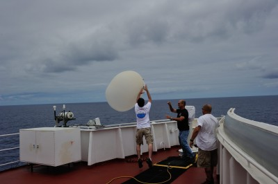 Weather balloon launch over ship's wing. Far left: Trevor Ferguson