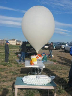 AirCore balloon and flight train, including parachute and telemetry beacons, being readied for a test launch in Colorado.