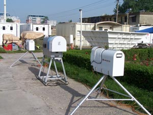A collection of radiometers (forefront), radar wind profiler (right), and instrument shelters (background) from the ARM Mobile Facility prepare for the 8-month deployment in Shouxian, China.