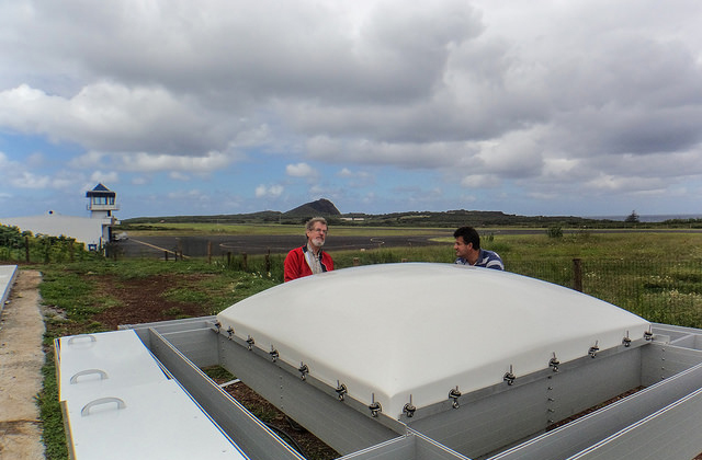 Richard Coulter (instrument mentor from Argonne National Laboratory) and Carlos Sousa (site operations) assemble the radar wind profiler.