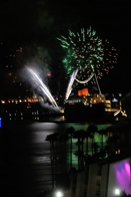 Queen Mary (orange stacks) and fireworks.