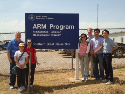 Commemorating the visit to the ARM Southern Great Plains site are (left of sign) John Schatz, SGP site operations manager, with Dr. Gyuwon Lee and daughter Sueha Lee; and (right of sign) Dr. Yeon-Hee Kim; Doug Sisterson, SGP site manager; Dr. Seungsook Shin; and Dr. Kwan-Young Chung.