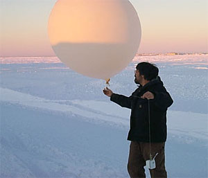 Jimmy Ivanoff, lead operator at the North Slope of Alaska ARM locale, launches a radiosonde during Phase II of the AIRS validation activity.