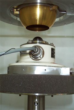 This photo shows a pyrgeometer entering the blackbody calibration chamber.  A blackbody is an object that absorbs all electromagnetic radiation that falls onto it. This lack of both transmission and reflection properties make blackbodies ideal sources for calibrating instruments that measure radiation, like the pyrgeometer.