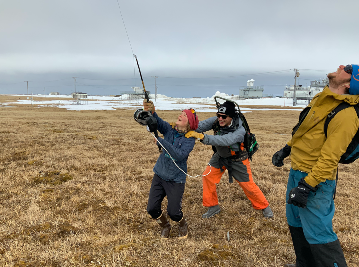 Research assistants launch a weather balloon at ARM's North Slope of Alaska atmospheric observatory