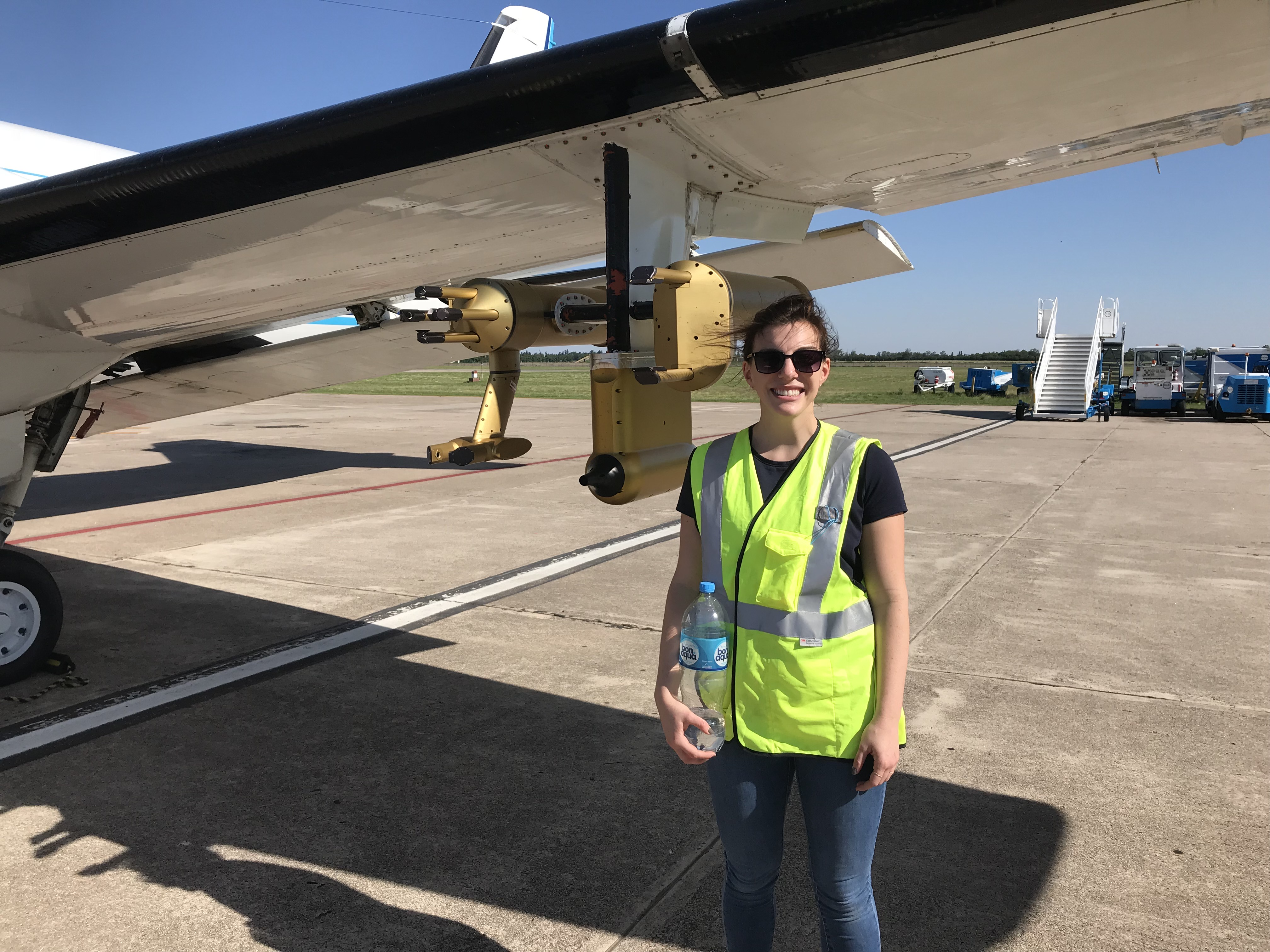 Lexie Goldberger stands next to aircraft