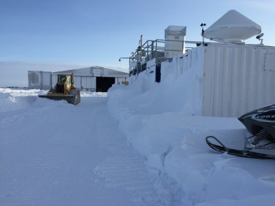 A plow moves snow from around the third ARM Mobile Facility during winter conditions. (File photo courtesy of Sebastian Biraud.)