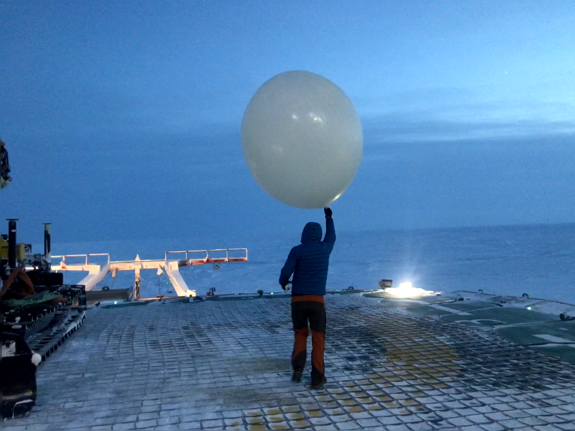 John Bilberry launches a weather balloon during MOSAiC