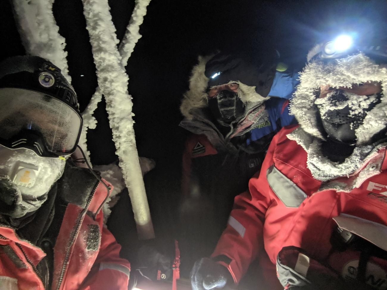 Dave Costa, Hans Honold, and Ola Persson work in the central Arctic during MOSAiC