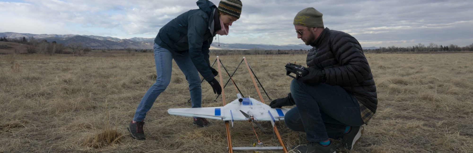 CIRES postdoctoral researcher Radiance Calmer (left) and Colorado University (CU) Boulder engineering graduate student Jonathan Hamilton place an unmanned aerial system on its launcher in preparation for its first test flight in Boulder, Colorado. It's the same kind they are using on the MOSAiC expedition to gather atmospheric data on temperature, pressure and humidity. Photo by Julia Medeiros.