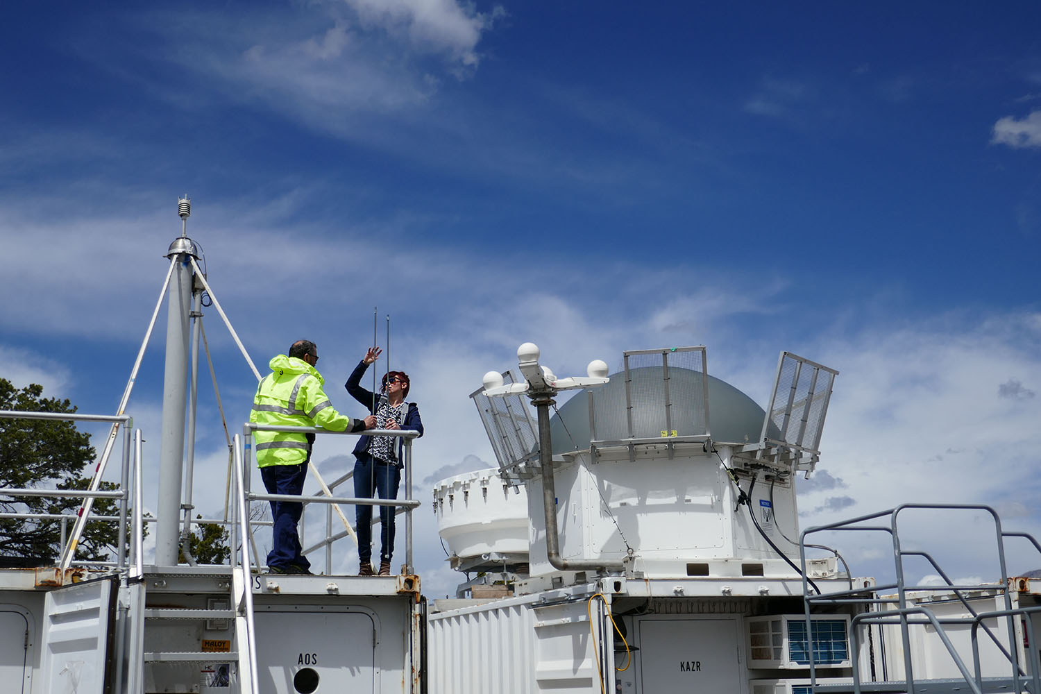 Jessie Creamean and Paul Ortega atop the Aerosol Observing System
