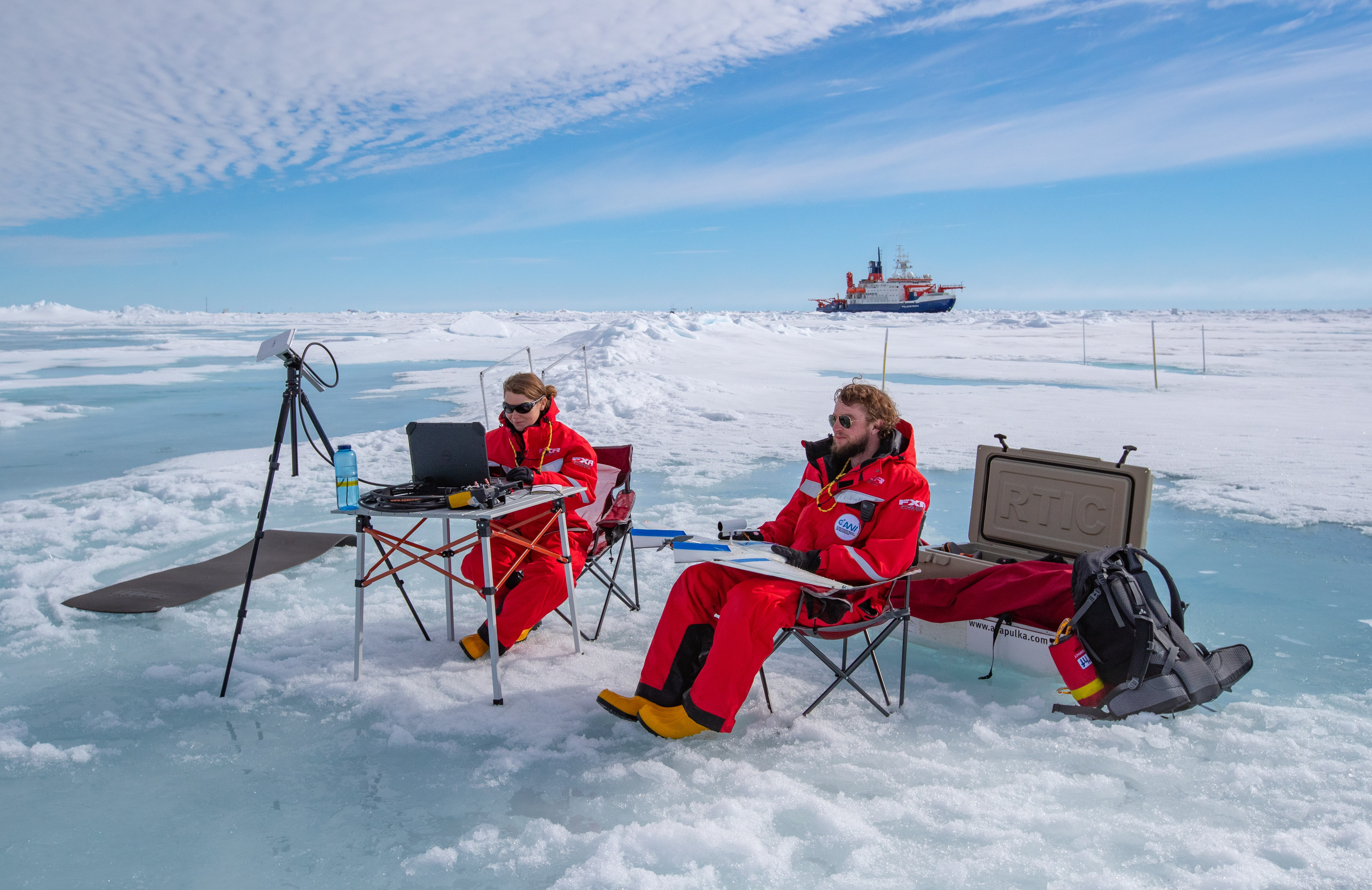UAS pilot Jonathan Hamilton and researcher Radiance Calmer work in the central Arctic during MOSAiC