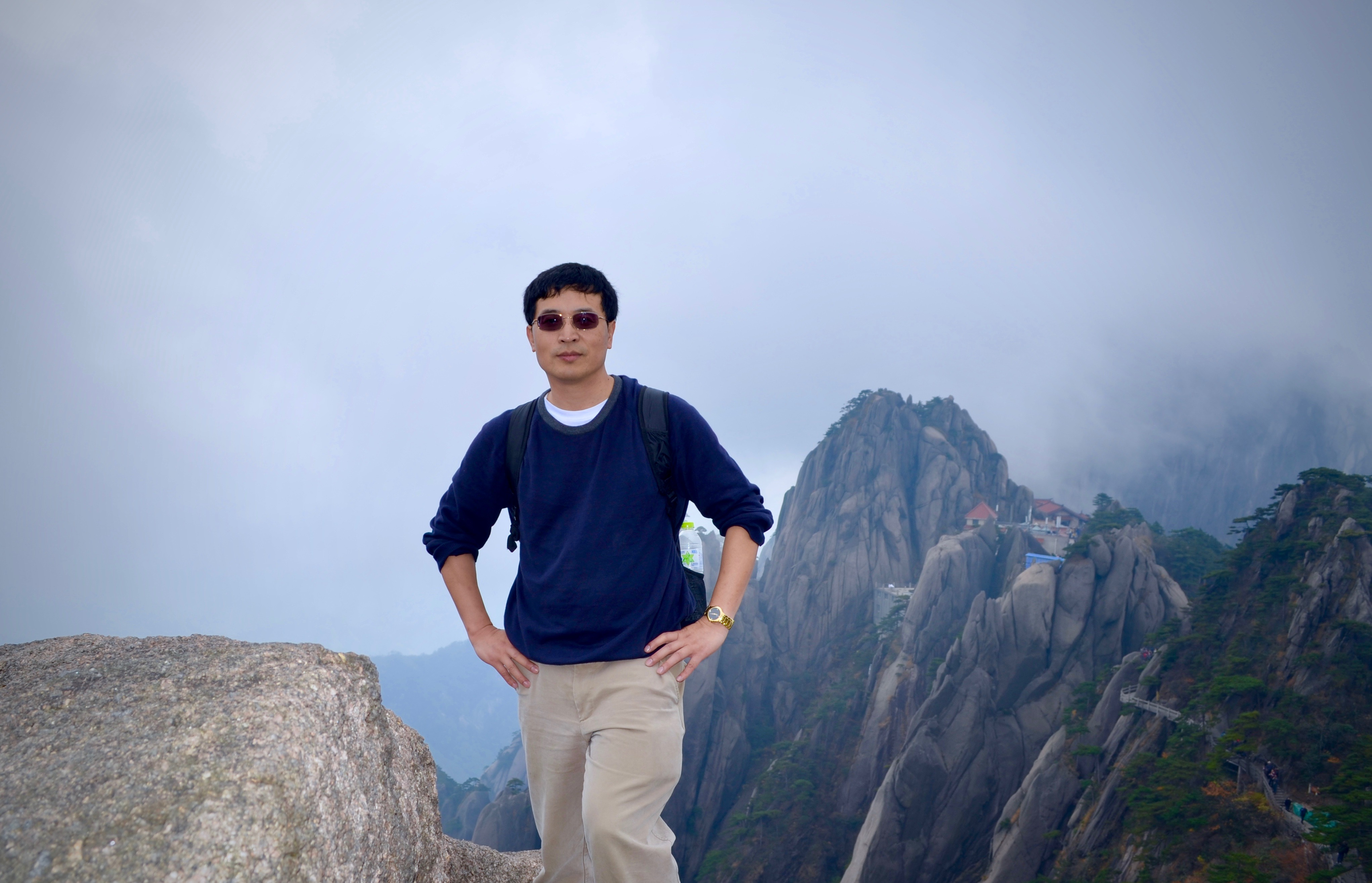 Shaocheng Xie, ARM's value-added products and translators lead, poses during a trek up Mount Huangshan in his native China.