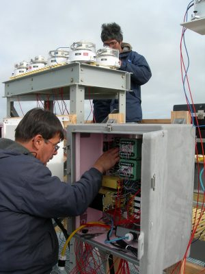 Walter Brower (left) and Jimmy Ivanhoff (right) work on radiometric instruments at the North Slope of Alaska's Barrow observatory.